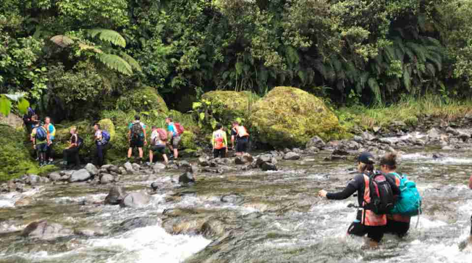 Competitors crossing river on Big Bang Adventure Race