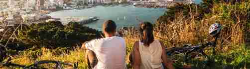 Couple taking in viewof Wellington city from Mt Vic