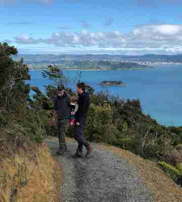 Muritai Park Track people on the track Somes Island and Wlg in the background