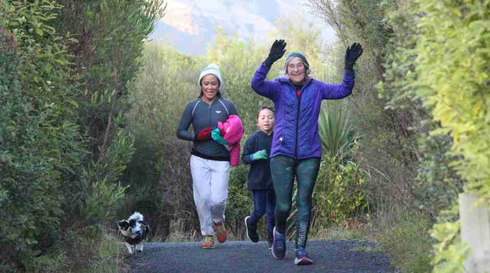 family with dog running at parkrun event
