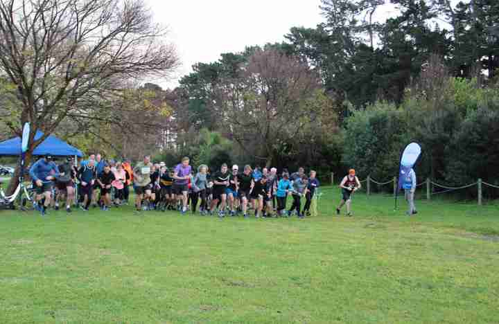 group of runner leaving the start line at parkrun event