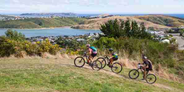 Porirua Grand Traverse multi-sport_ people running on track Porirua background