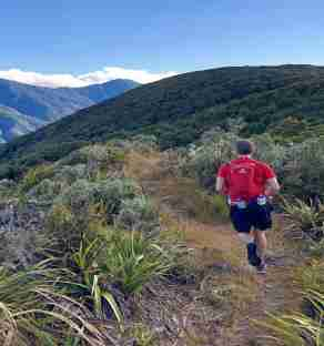 Tararua Mountain Race_man running on track among green hills